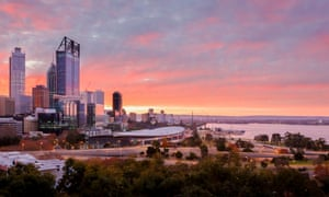 The city of Perth, Western Australia, taken from near Jacobs ladder Kings Park at Sunrise. View of the City of Perth, Kings Park and the Swan River.