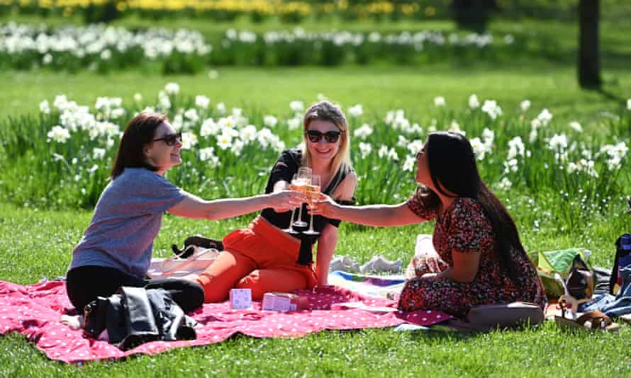 People in St James's Park, London, enjoy the easing of lockdown restrictions on Monday.