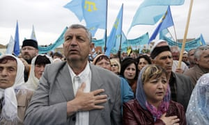 Crimean Tatars attend a memorial ceremony marking the 70th anniversary of the deportation of Tatars from Crimea, near a mosque in Simferopol, in 2014.