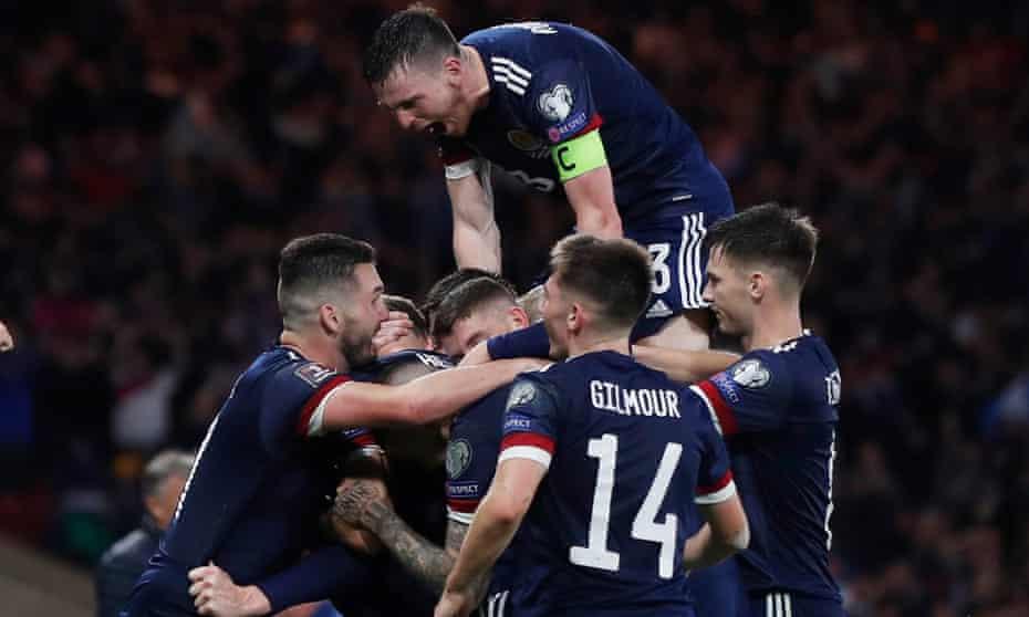 Scotland players celebrate Scott McTominay's late winner.