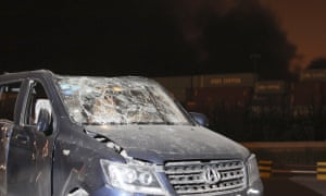 A damaged vehicle near the site of the blasts in Tianjin.