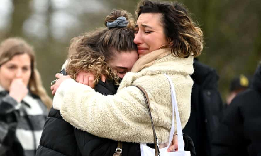 Two women embrace as they stand before tributes for Sarah Everard at the bandstand on Clapham Common on 13 March.