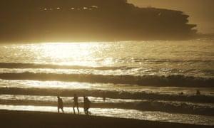 Early morning joggers run along the shore at Bondi Beach in Sydney.