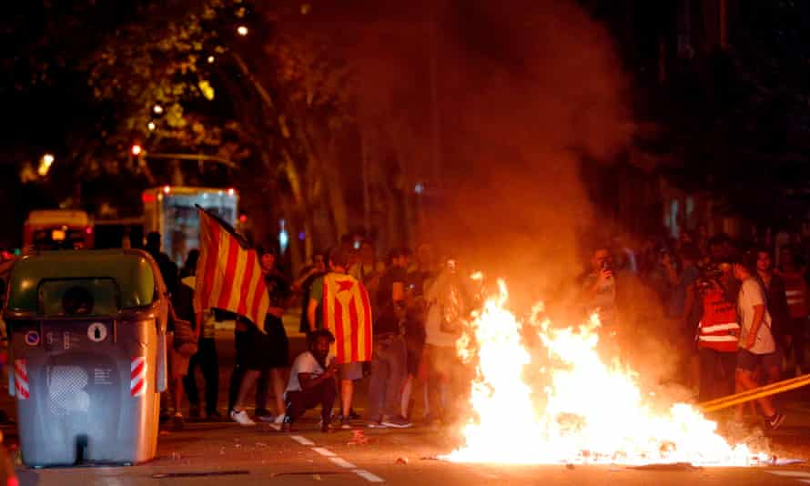 Protesters burn rubbish during the demonstration in Barcelona.