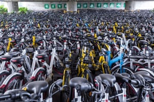 A sea of dockless share bikes beneath an overpass in Hangzhou, China.
