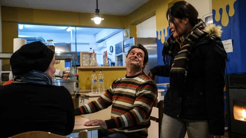 Home for All founders Nikos Katsouris and Katerina Koveou, left, say goodbye to Afghan asylum-seeker Zakira Naderi, at their establishment last month.