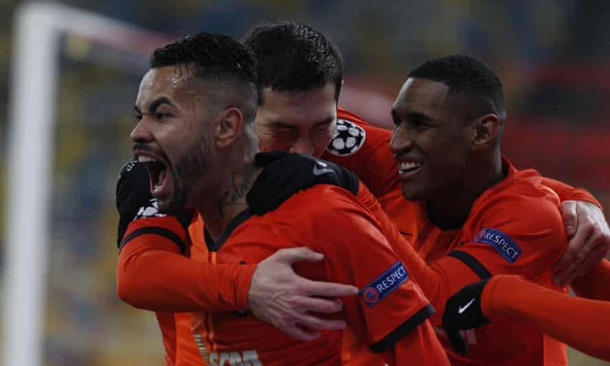 Dentinho (left) celebrates his opening goal for Shakhtar Donetsk