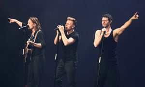 Elder statesmen … from left, Mark Owen, Gary Barlow and Howard Donald of Take That performing at the O2 Arena.