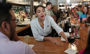 Alexandria Ocasio-Cortez serves drinks in support of One Fair Wage at the Queensboro restaurant in Queens, New York, on 31 May 2019.