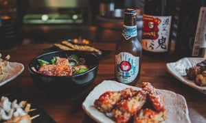 A selecton of dishes and a bottle of beer at Bincho Yakitori, Brighton.