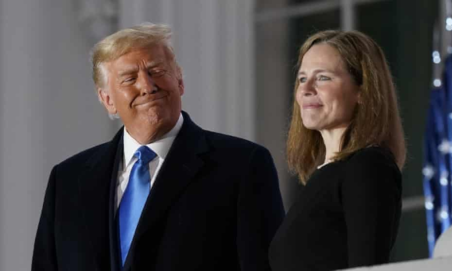 Donald Trump and Amy Coney Barrett stand on the Blue Room balcony after her swearing-in as a supreme court justice in October 2020.