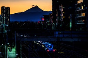 Tokyo, Japan: a shinkansen (bullet train) is seen with Mount Fuji looming in the distance