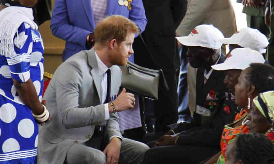 Prince Harry speaks with Jaston Khosa and other veterans at Burma Barracks in Lusaka, Zambia, in 2018