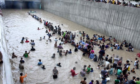 People are flooded in Karachi on Thursday.