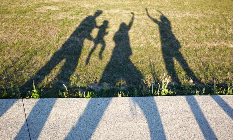 shadow on ground of family figures