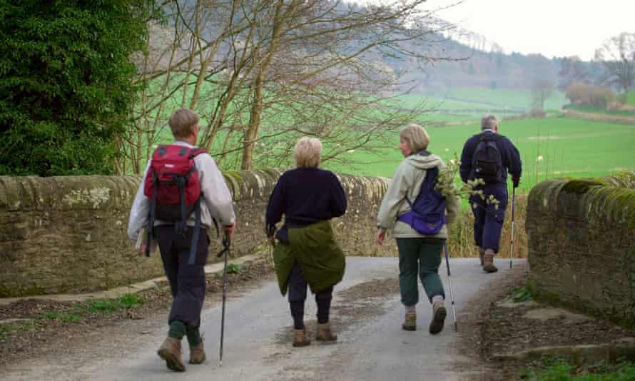 Walkers crossing the River Lugg at Lyepole Bridge, on the Mortimer Trail between Ludlow and Kington