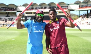 Chris Gayle and Oshane Thomas (right) of the West Indies celebrate their victory.