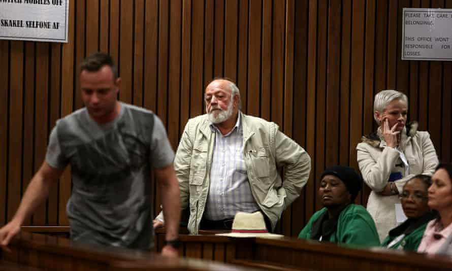 Reeva Steenkamp's father Barry watches Pistorius in the courtroom.