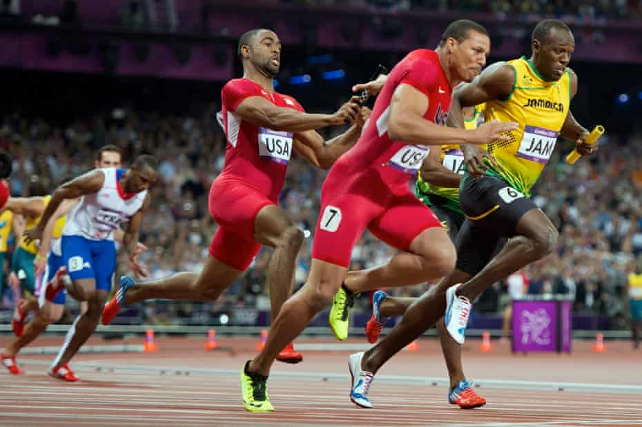 Tyson Gay hands the baton to his US teammate Ryan Bailey in the 4x100m relay final at London 2012. Gay later tested positive for anabolic steroids.