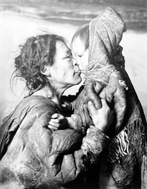 Richard Harrington. Inuit Mother Caresses Her Child in Igloo, Padleimut Tribe, N.W.T.