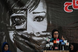 A social worker addresses Afghan women against the claimed human rights violations in Kabul