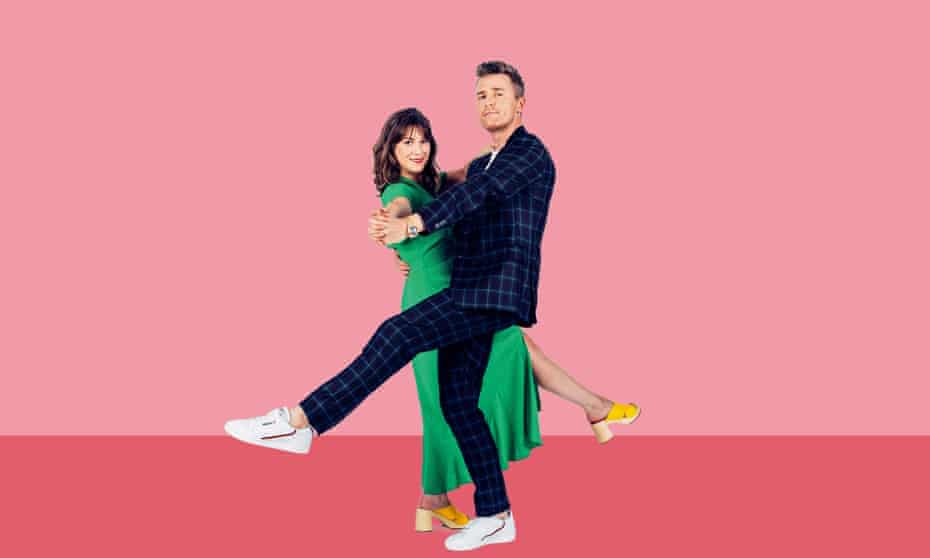 Blind date superfan Justin Myers and matchmaker Nina Trickey holding each other in a dance pose against pink background