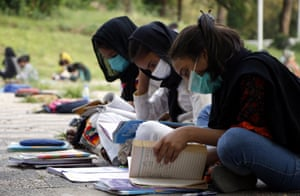 Girls take classes at an open air free school run in Islamabad.