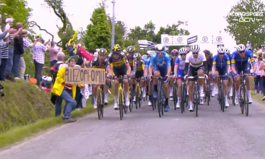 The 30-year-old French woman and the large cardboard sign that caused a mass crash during Saturday's opening stage of this year's Tour de France