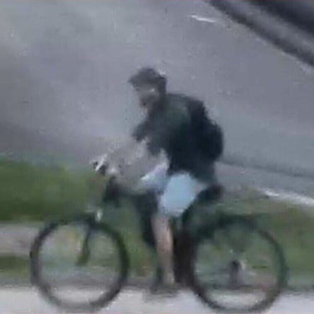 A French police handout showing the suspect on his bicycle.