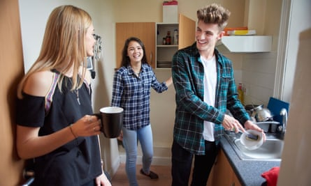 students chat in the kitchen.