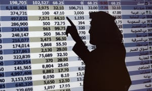 The shadow of a Saudi trader is seen on a stock market monitor in Riyadh