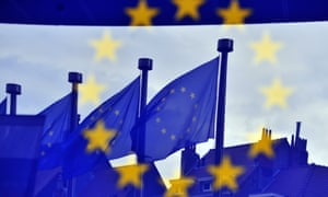 European flags are reflected at the entrance of the Berlaymont building EU Commission in Brussels.