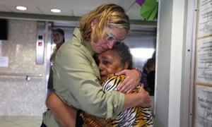 Yulín Cruz, left, hugs a resident.