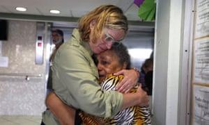 San Juan's Mayor Carmen Yulin Cruz (L) hugs a woman during her visit to an elderly home in San Juan, Puerto Rico, 22 September 2017.