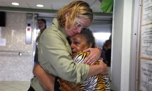 Carmen Yulín Cruz hugs a woman during her visit to an elderly home in San Juan, Puerto Rico on 22 September 2017.