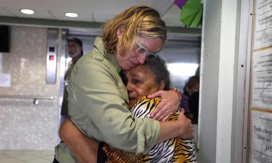 Carmen Yulín Cruz hugs a woman during her visit to an elderly home in San Juan on 22 September 2017.
