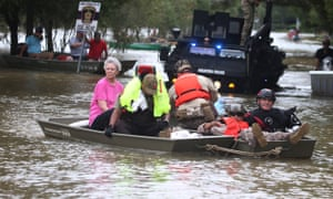 A rescue boat evacuates people from rising waters following Hurricane Harvey in a neighborhood west of Houston, Texas.