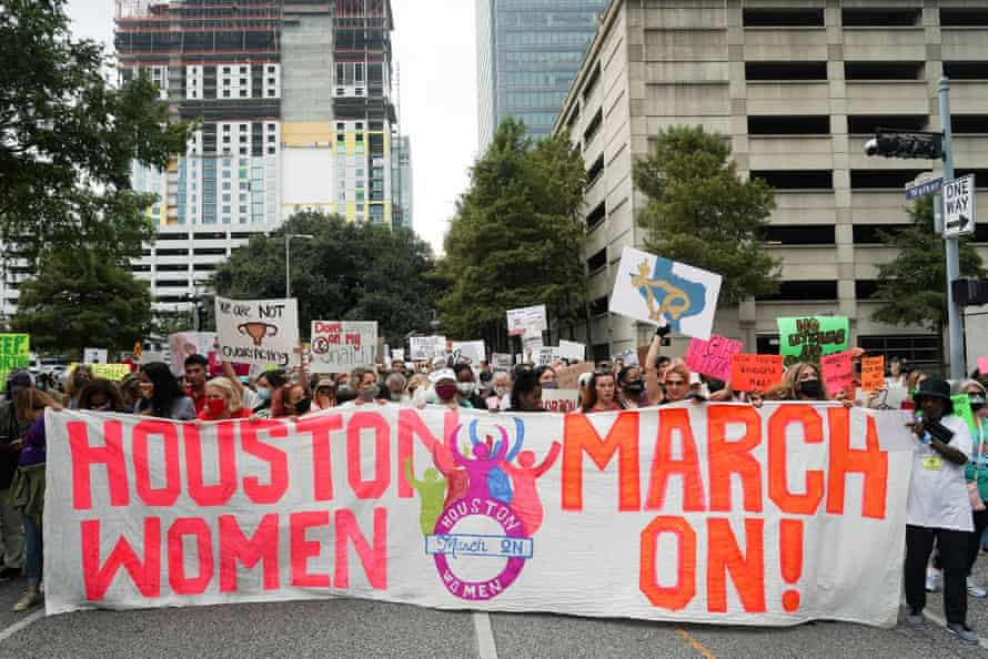 Abortion rights supporters participate in the nationwide Women's March held on 2 October.