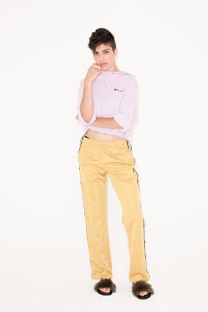 pale yellow trousers with black and white stripes up the side, Fila, pale purple hoodie, Weekday, black fluffy sliders Dune