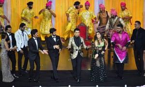 From left: Nushrat Bharucha, Varun Dhawan, Ayushman Khurrana, Riteish Deshmukh, Kartik Aaryan, Karan Johar, Kriti Sanon, Arjun Kapoor and Boman Irani perform at the 2018 IIFA awards.