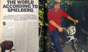 A mocked up picture of an open book with the feature on the left (and a cutout of ET bottom left)  and a picture of a bearded Spielberg on the ET BMX on the right