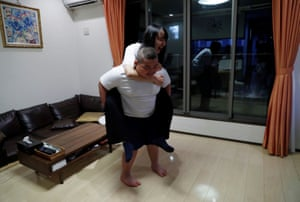 Kumagai carries his sister Nanami, 16, on his back after dinner