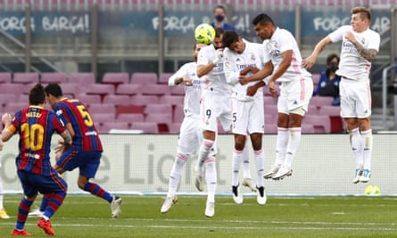 Lionel Messi sends a free-kick into the wall.