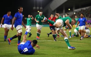 Jordan Larmour of Ireland scores his team's fifth try past Dwayne Polataivao of Samoa.
