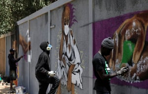 Dakar, Senegal Graffiti artists work on a mural to encourage people to protect themselves