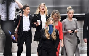 London, England Amber Heard, centre, arrives with her girlfriend Bianca Butti, left, at the Royal Courts of Justice