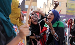 People celebrate on the streets of Khartoum after the deal was announced.