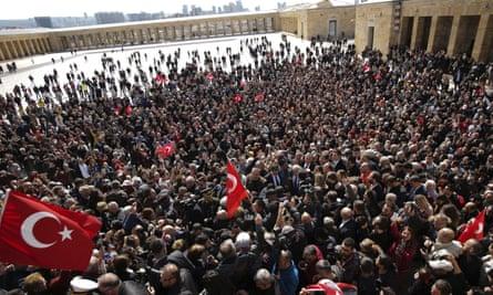 Ekrem İmamoğlu is surrounded by cheering supporters as he visits the mausoleum of Mustafa Kemal Atatürk in Ankara