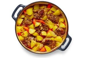 Potatoes, onions, meat and carrots in a pan