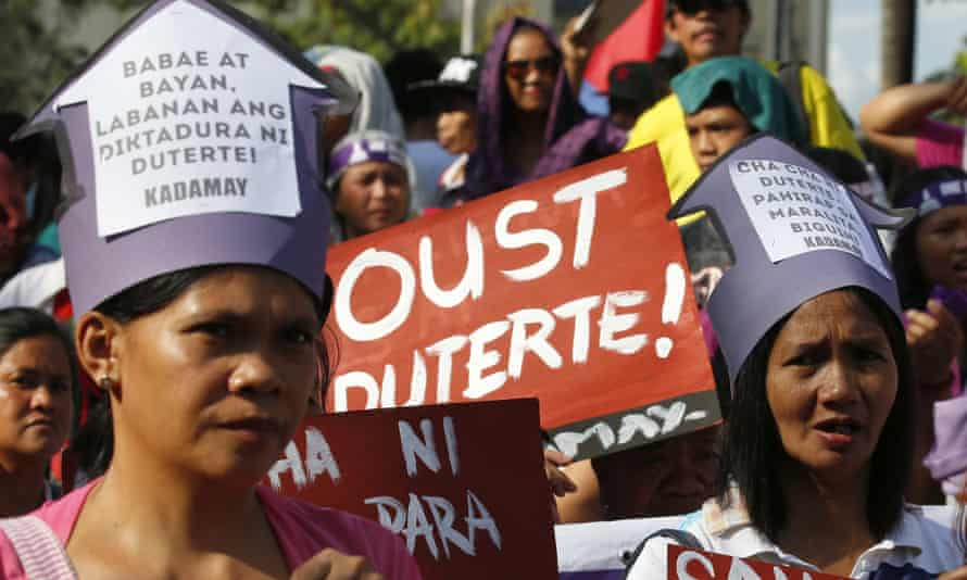 Protesters march towards the presidential palace in Manila.